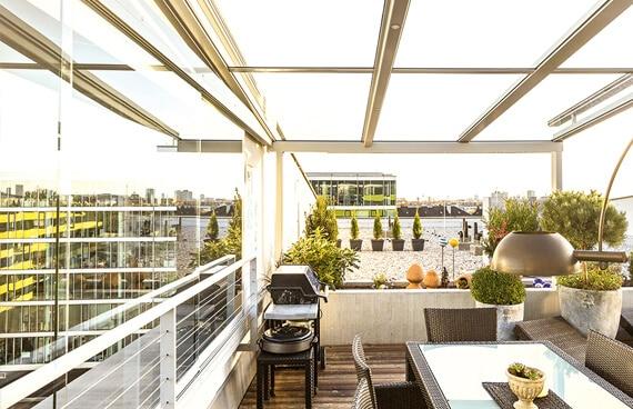 verglaste terrasse polstersessel outdoor kaminofen