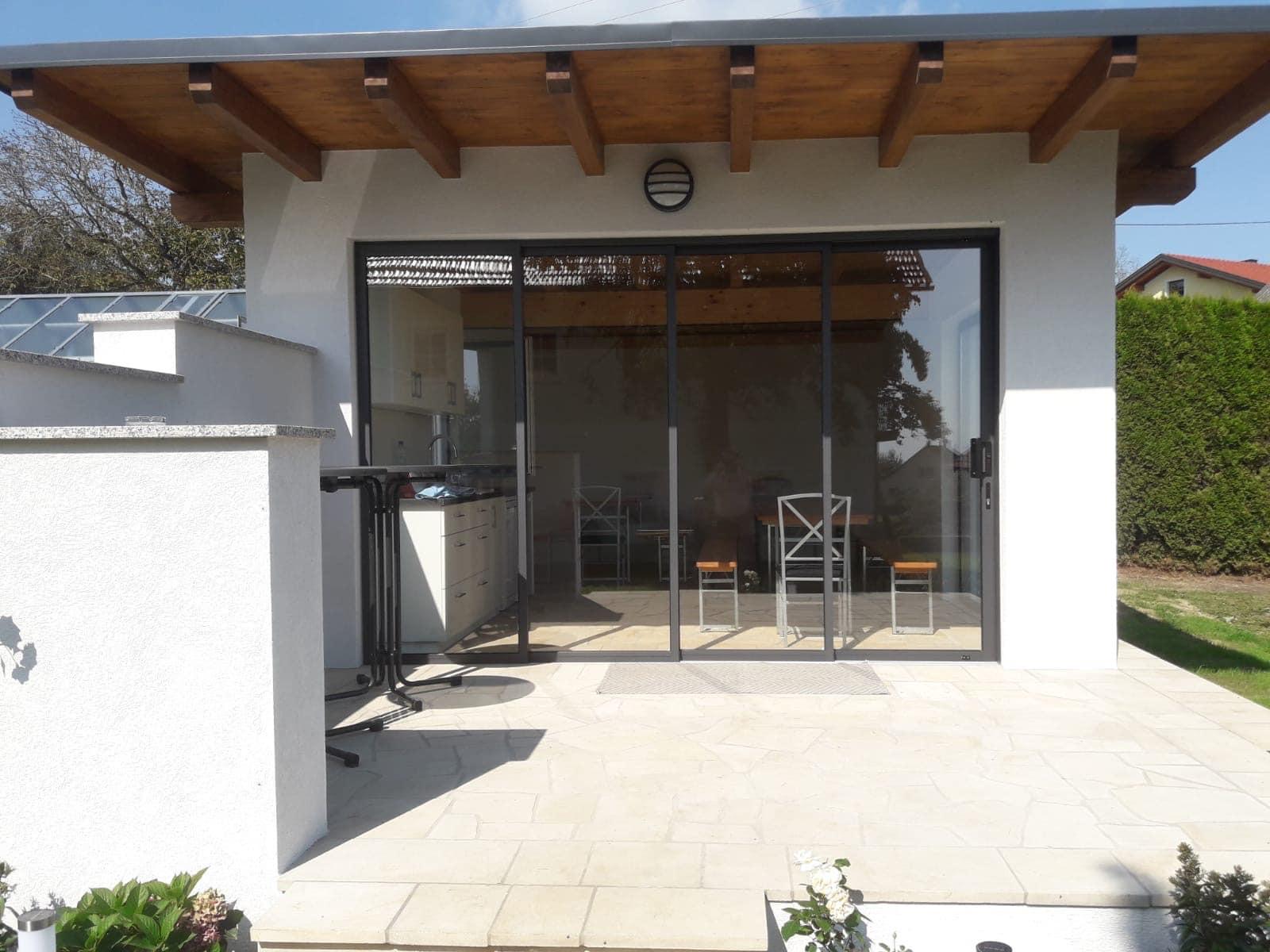 Gartenhaus Pultdach modern mit Schiebetür