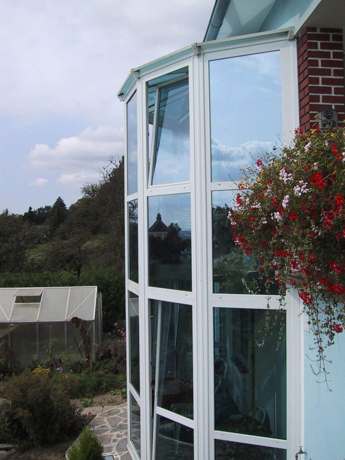 Balkonverkleidung aus Glas zum Falten Fenster Schmidinger