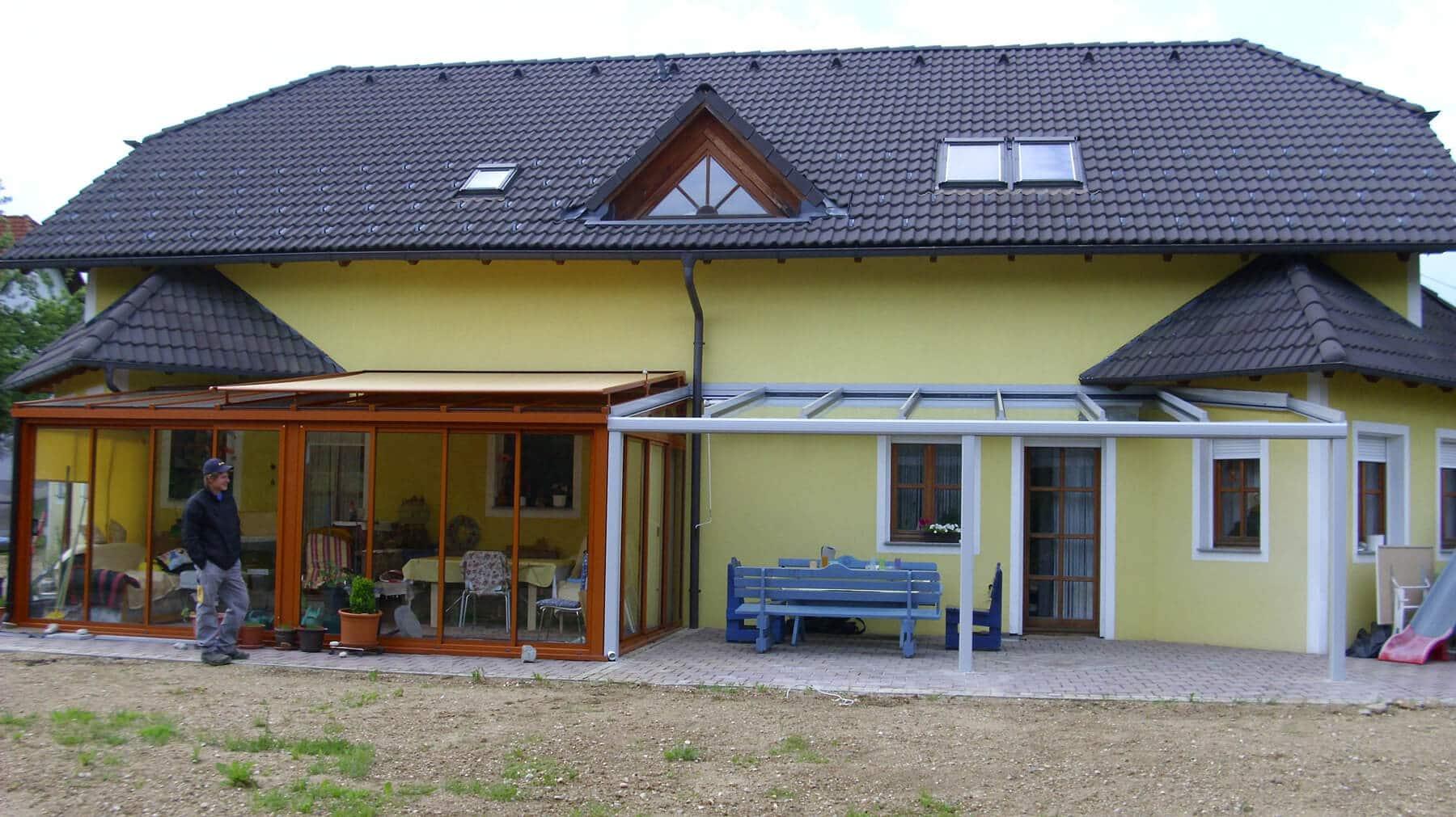 Verlängerung des Wintergartendaches mit einer Terrassenüberdachung