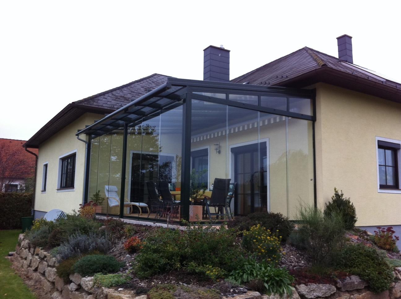 Wintergarten mit Sunflex SF 20 Ganzglas-Schiebe-System